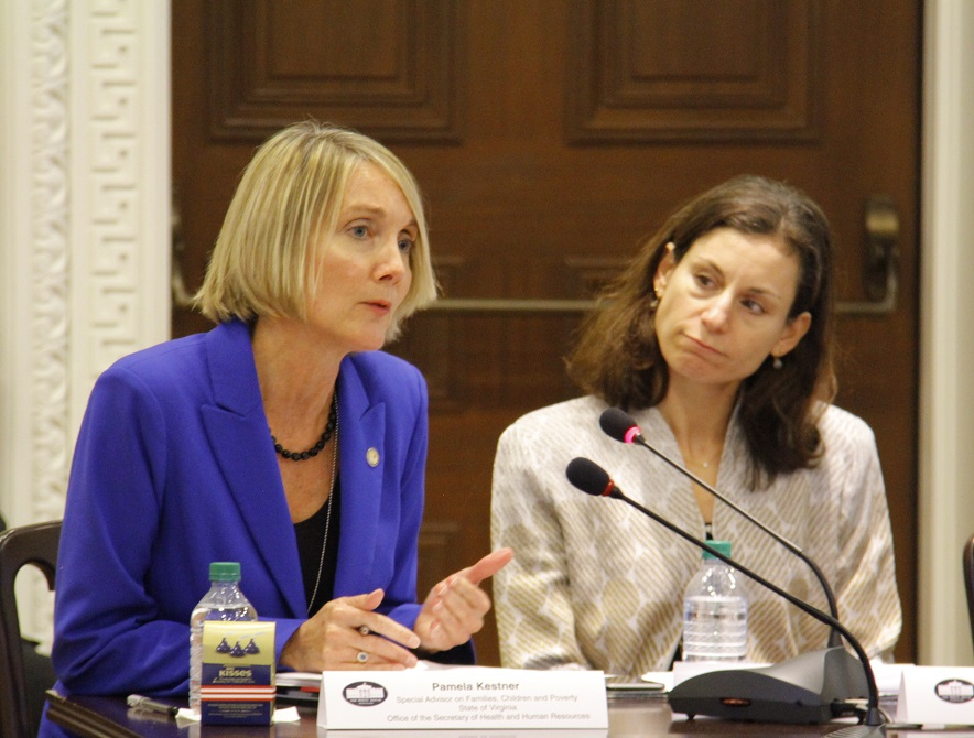 Pam Kestner, representing Virginia, and Laura Zeilinger, representing Washington, DC, speak at December Council meeting