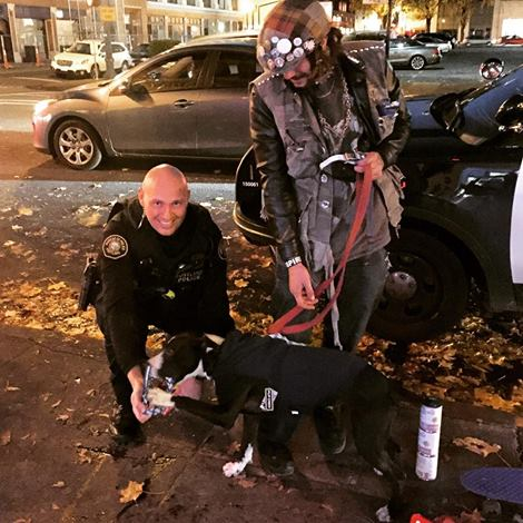 Portland, Oregon Police Officer with youth living on the streets with pet dog.